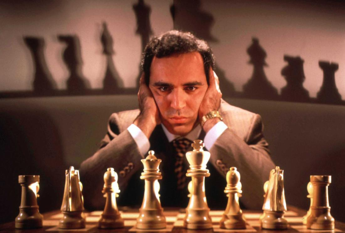 Chess champion Gary Kasparov contemplating board, training for his May rematch w. smarter version of Deep Blue, IBM computer that spooked him last yr.  (Photo by Ted Thai/The LIFE Picture Collection/Getty Images)