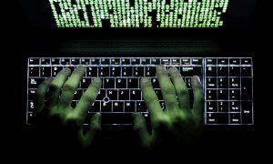Hacker, cyborg programmer on a computer
